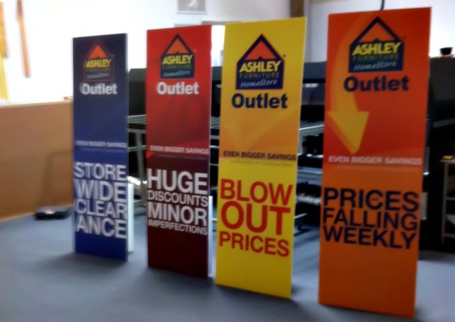 ashley furniture outlet pop signs 2
