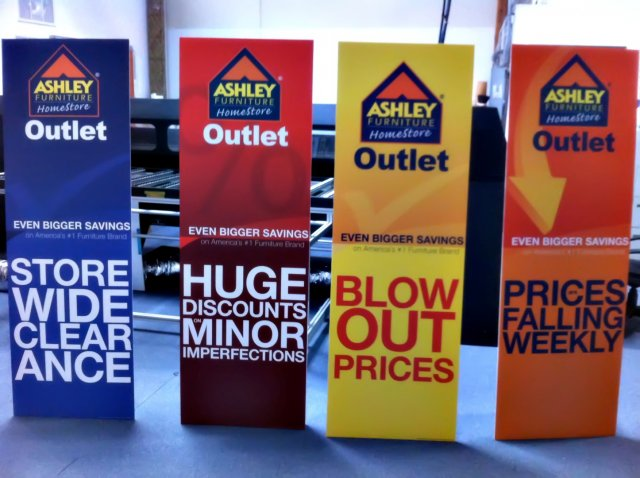 ashley furniture outlet pop signs